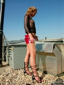 Mia - Teases In Tight Shiny Red Miniskirt