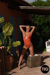 Adele Taylor - Babe in An Orange Bodysuit g6x7td5jtw.jpg