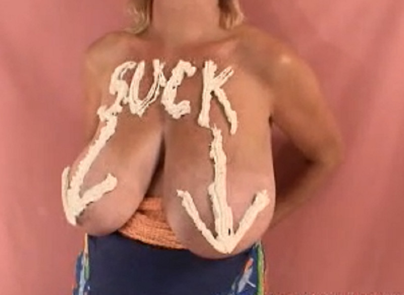 Rubbing cream into tits