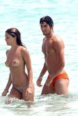 Belen Rodriguez topless @ the beach q6rmmgc7ms.jpg